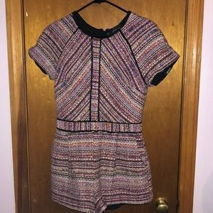 Tweed romper with leather trim